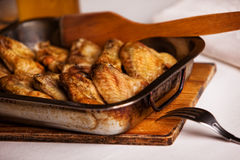 Fried chicken wings in the oven-pan Royalty Free Stock Photos