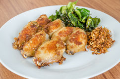 Fried chicken wings over white dish Stock Photography