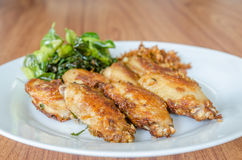 Fried chicken wings over white dish Stock Photo