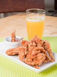 Fried chicken wings with pineapple juice Stock Photos