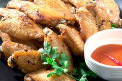 Fried chicken wings on a plate with black pepper sauce. Royalty Free Stock Photo