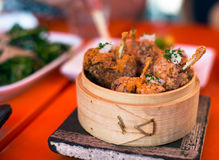 Fried chicken wings on  plate made ​​of birch bark Royalty Free Stock Images
