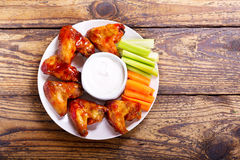 Fried chicken wings. Plate of fried chicken wings with sauce Stock Photography