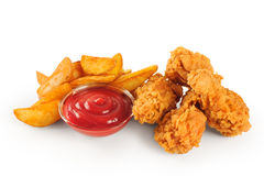 Fried chicken wings potatoes and ketchup Royalty Free Stock Images