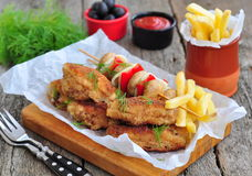 Fried chicken wings with red sauce and French fries  potatoes Stock Image