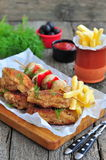 Fried chicken wings with red sauce and French fries  potatoes Royalty Free Stock Image