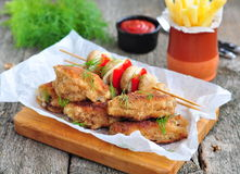 Fried chicken wings with red sauce and French fries  potatoes Stock Photo