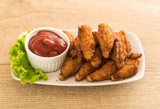 Fried chicken wings. With sauce Stock Images