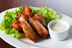 Fried chicken wings with sauce Royalty Free Stock Photos