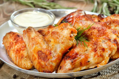 Fried chicken wings with sauce. Close up view Stock Images