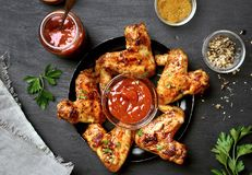 Fried chicken wings with sauce on dark background Stock Photography