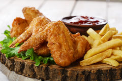 Fried chicken wings. With sauce and French fries Stock Photography