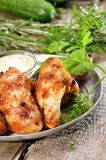 Fried chicken wings with sauce Royalty Free Stock Images