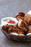 Fried chicken wings with sauce Stock Photography