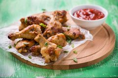 Fried chicken wings with sauces Royalty Free Stock Photos