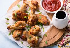 Fried chicken wings with sauces Stock Images