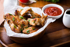 Fried chicken wings with sauces Royalty Free Stock Images