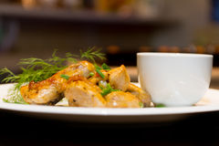 Fried chicken wings with source on white plate Stock Images