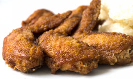 Fried chicken wings. On white backgroud Royalty Free Stock Photo