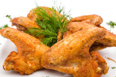 Fried Chicken Wings on white. Fried Chicken Wings on plate, white background Royalty Free Stock Images
