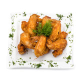 Fried Chicken Wings on white. Fried Chicken Wings on plate, white background Stock Image