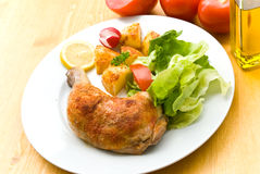 Fried Chicken With Fried Potatoes,lettuce And Toma Royalty Free Stock Image