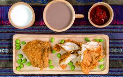Fried Chicken on Wooden Plate stock photography