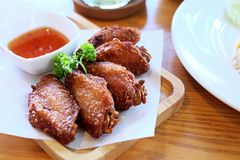 Fried Chickens With Red Sauce. Some fried chickens with red sauce on the wooden plate Stock Photos