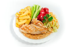Fried  chiken meat  with french fries and salad Stock Images
