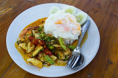 Fried chilly paste with shrimps, squid, fish and fried egg Stock Image