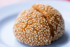 Fried Chinese bun. Fried Chinese dumpling bun with white sesame sprinkle Stock Images