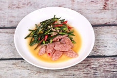 Fried Chinese chives with Thai sour sausage . Royalty Free Stock Photos