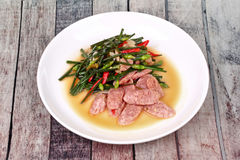 Fried Chinese chives with Thai sour sausage . Stock Photos