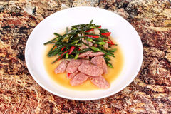 Fried Chinese chives with Thai sour sausage . Stock Image