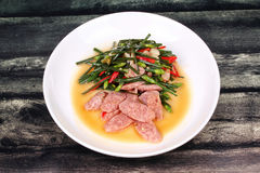 Fried Chinese chives with Thai sour sausage . Royalty Free Stock Images
