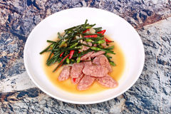 Fried Chinese chives with Thai sour sausage . Stock Photography