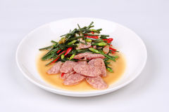 Fried Chinese chives with Thai sour sausage . Stock Photo