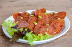 Fried Chinese sausage ready to be served. Thai style stock photography