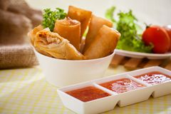 Spring rolls. Fried Chinese Spring rolls on table royalty free stock photo
