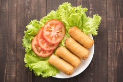 Fried Chinese traditional spring rolls on wooden background. Royalty Free Stock Photos