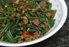 Fried chive bud and meat. For Chinese style meal stock photos