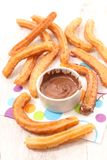 Churros and chocolate dip. Fried churros and chocolate dip Stock Image