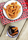 Fried churros with cinnamom sugar and chocolate sauce Stock Image