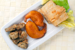 Fried Cob, Battered Artichoke and Prawn Tail Royalty Free Stock Photos