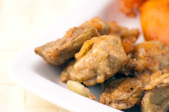 Fried Cob, Battered Artichoke and Prawn Tail Stock Photos