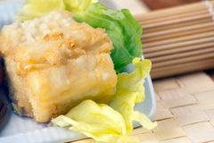 Fried Cob, Battered Artichoke and Prawn Tail. A white rectangular plate with Fried Cob, Battered Artichoke and Prawn Tail stock photo