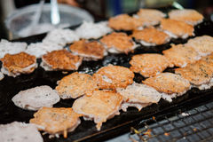 Fried coconut pancake or Baa Bin on hot stove at thailand. Stock Photos