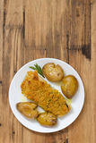 Fried cod with bread and potato on dish Royalty Free Stock Photos