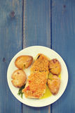 Fried cod with broa and potato on dish Stock Image
