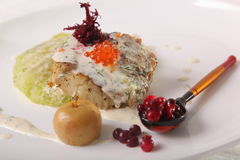 Fried cod with caviar. In Russian style Stock Image